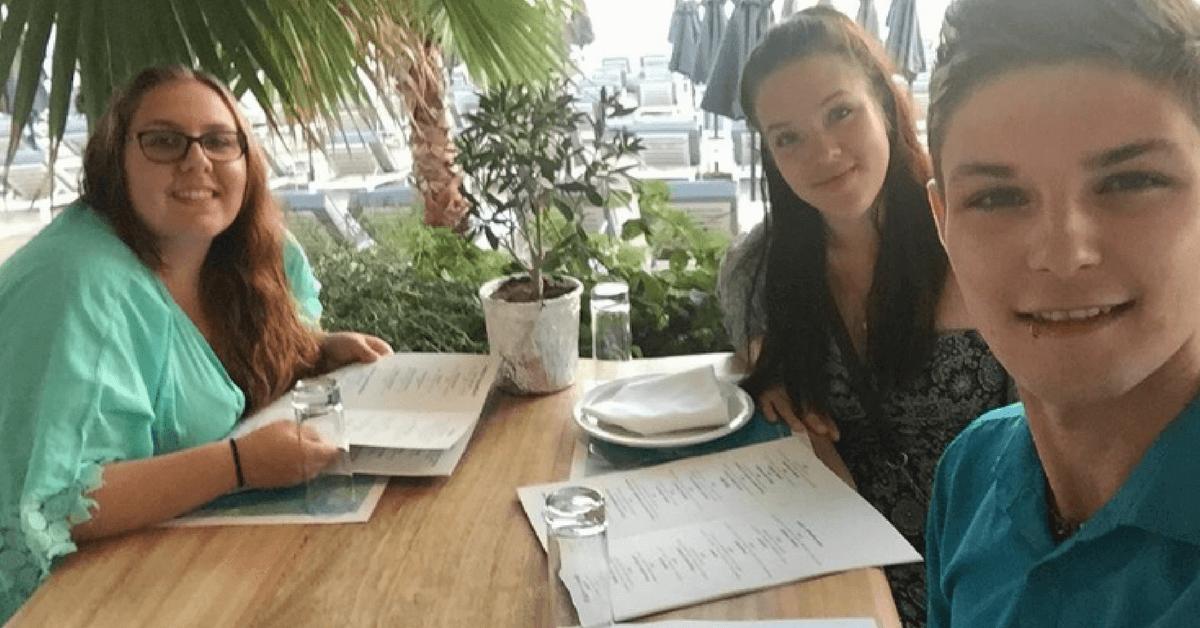 enjoying greece food at a restaurant in mykonos