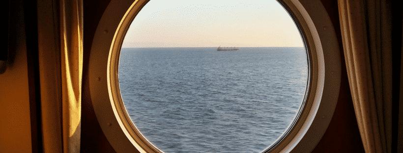 A port hole on a cruise ship