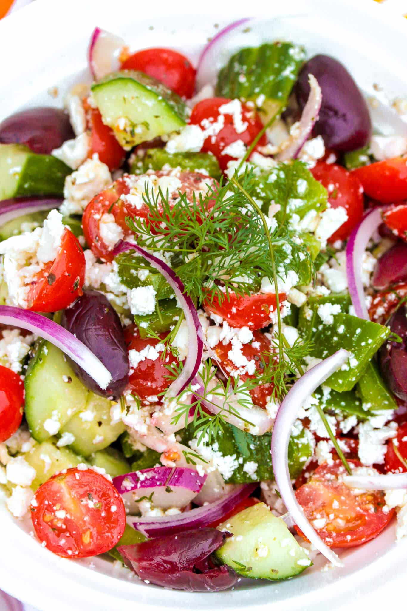 This easy Greek salad is one of my favorite authentic Greek recipes! It comes out fresh and delicious every time. #gayglobetrotter #greeksalad #salad #greekrecipe #tomato #cucumber #greek