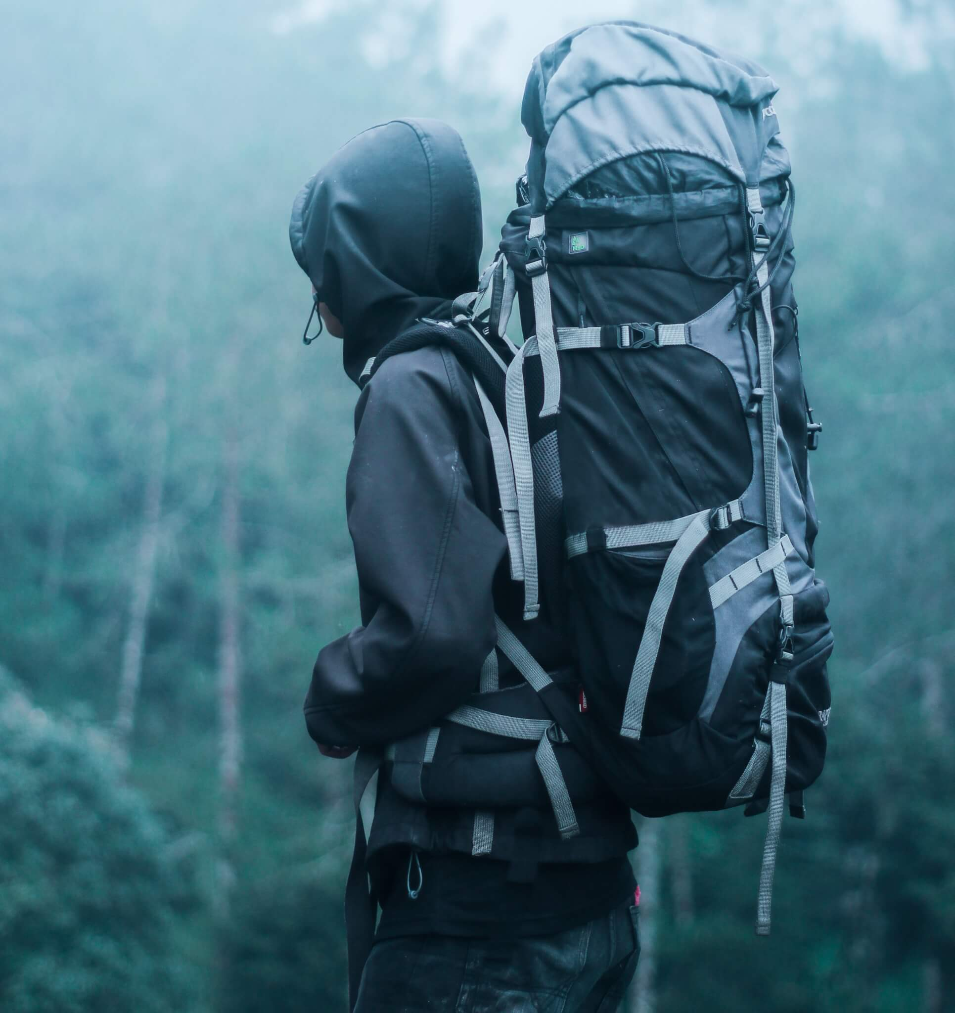 A man with a large backpack hiking.