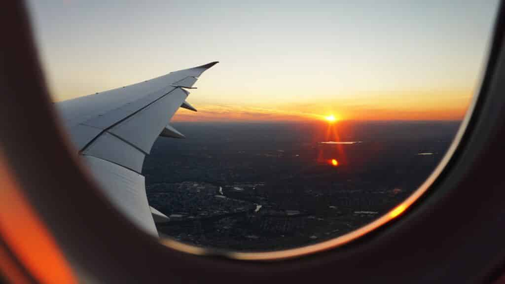 Looking out of an airplane window at the sunset