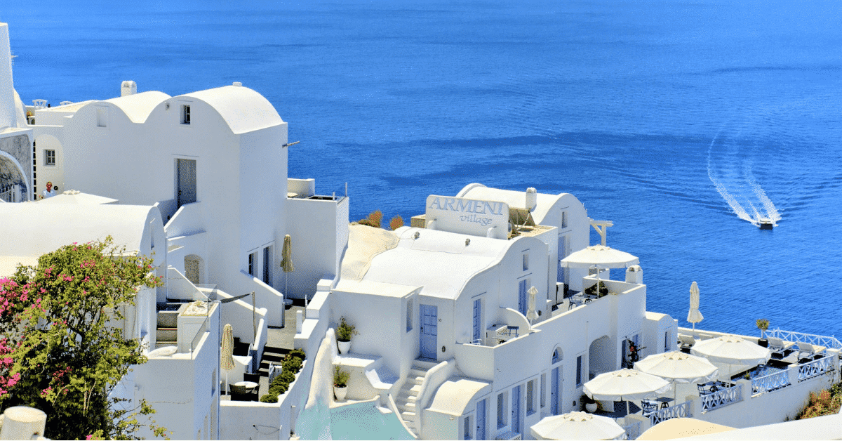 Blue ocean and iconic Greek architecture.