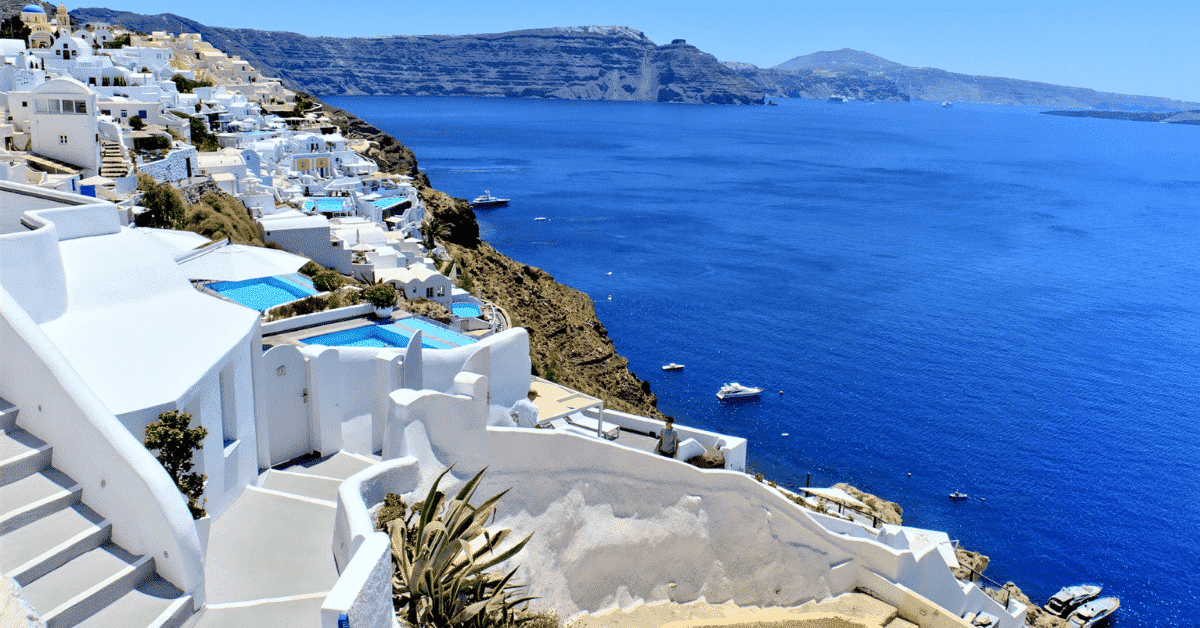 Santorini architecture and blue waters.