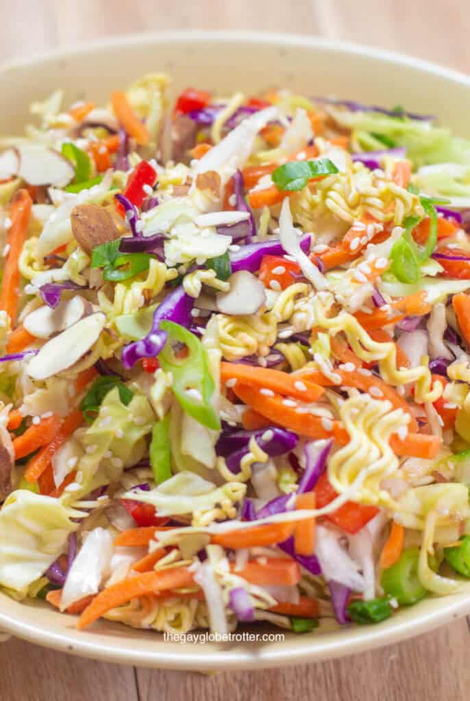 A bowl full of ramen noodle salad with Asian sesame dressing.