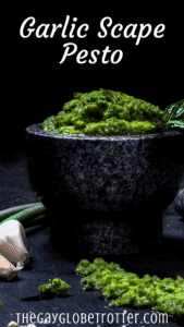 "Garlic scape pesto in a bowl with text overlay that reads ""garlic scape pesto"""