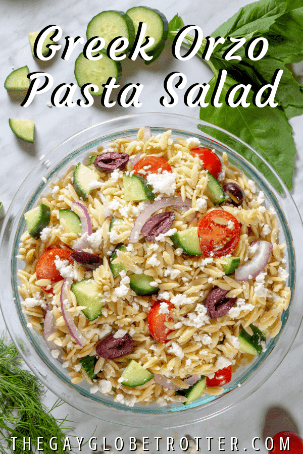 "A bowl of Greek orzo pasta salad with text overlay that reads ""Greek orzo pasta salad"""