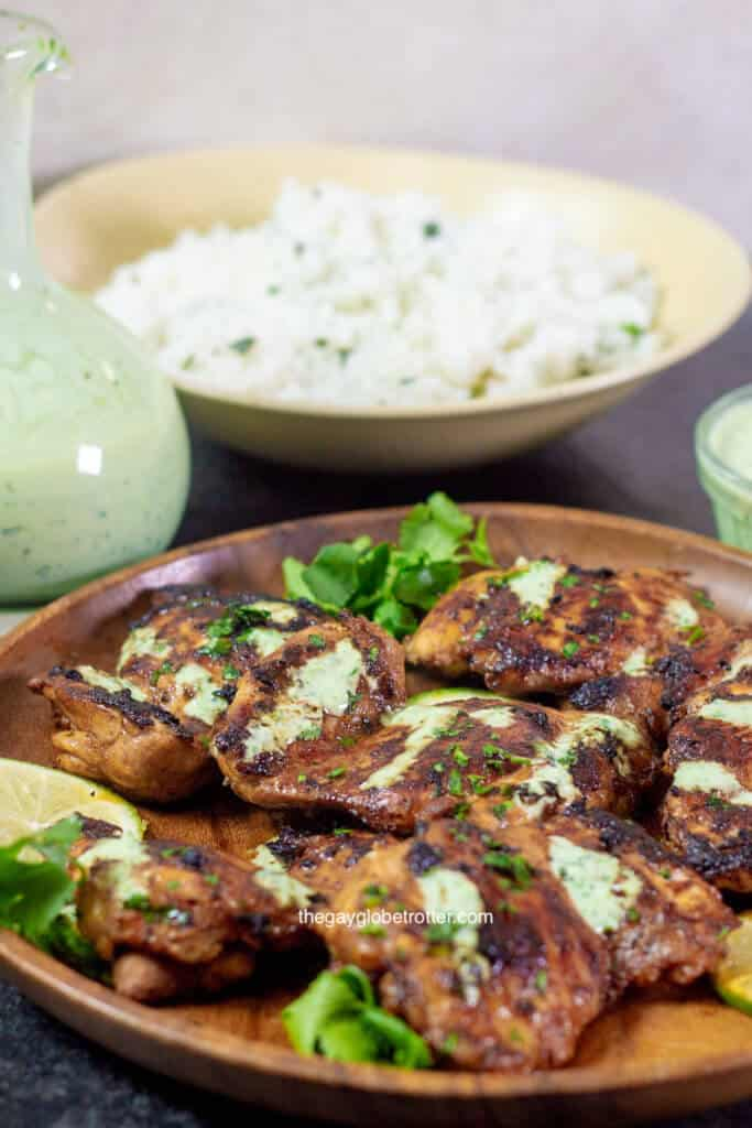 Peruvian chicken (pollo a la brasa) with cilantro lime rice and aji verde ready to be served.