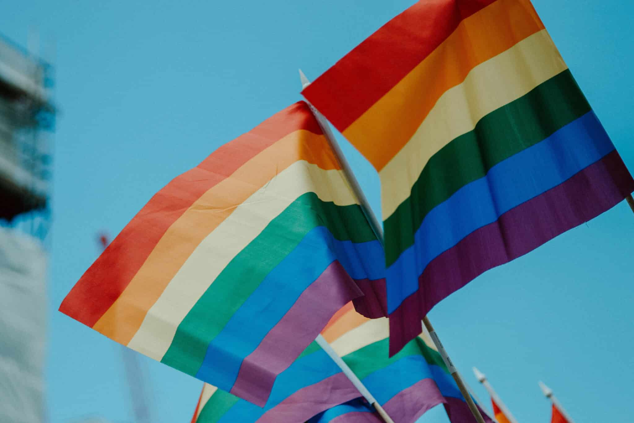 Three rainbow flags