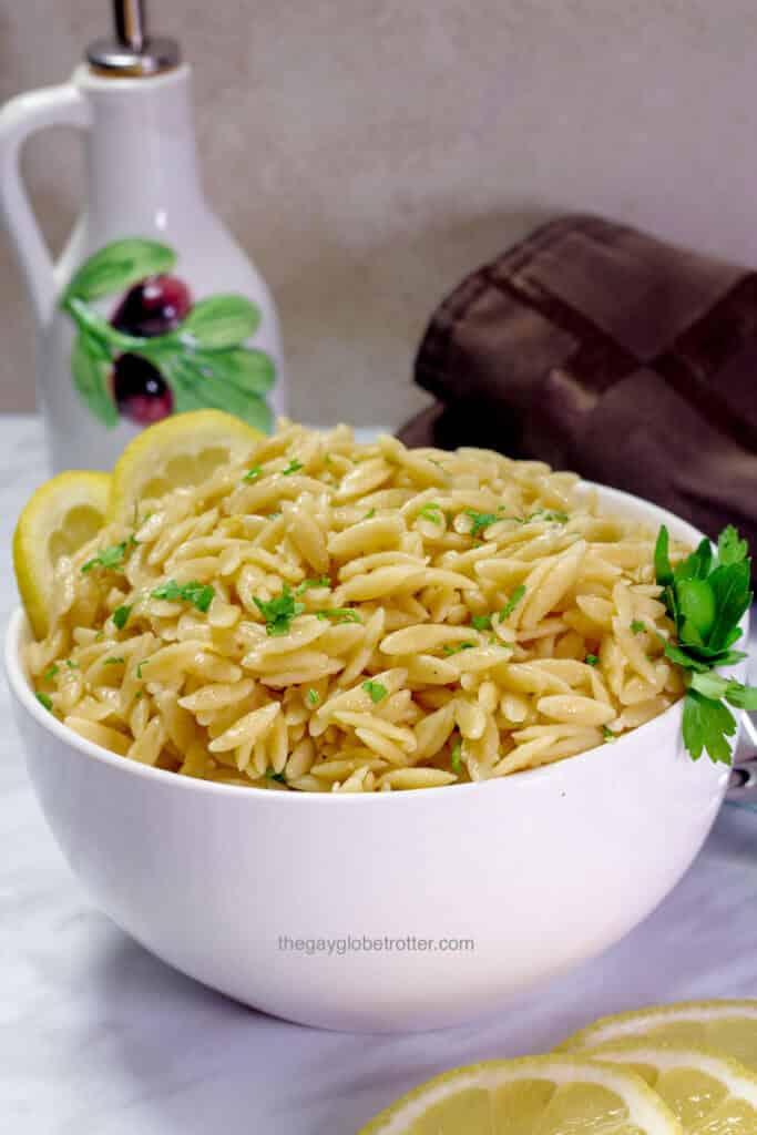A serving bowl full of lemon parmesan orzo.