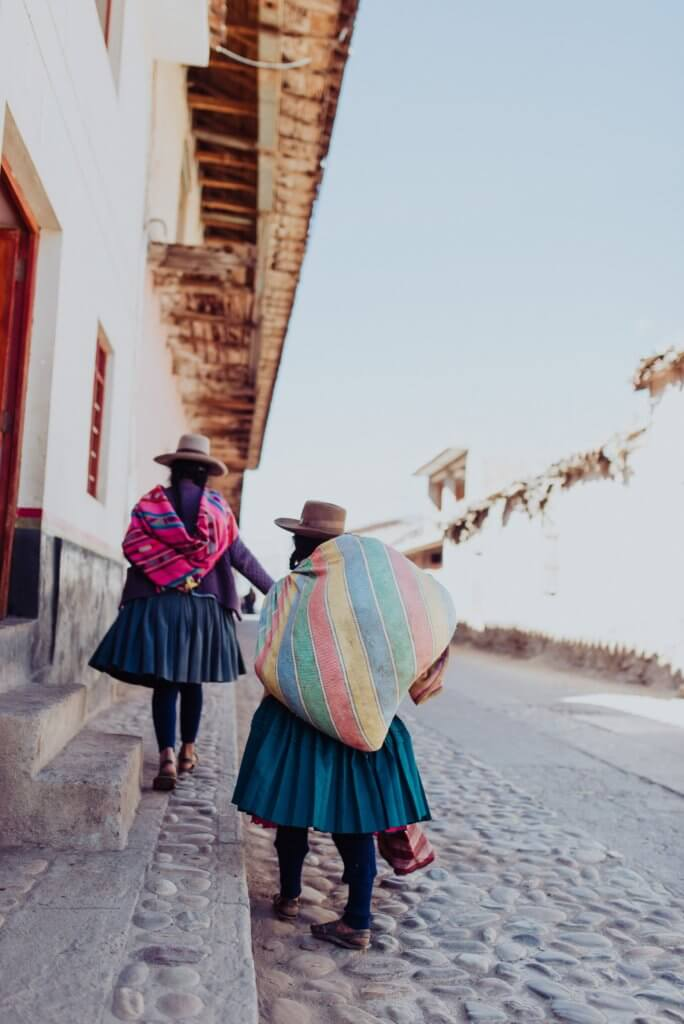 Women on a street in Peru.