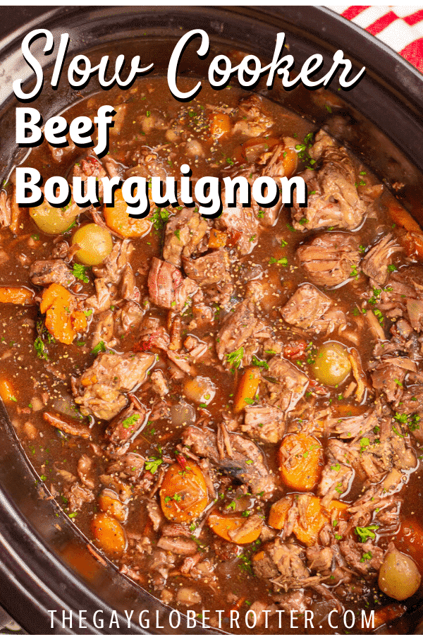 "Beef bourguignon in a slow cooker with text overlay that says ""slow cooker beef bourguignon"""