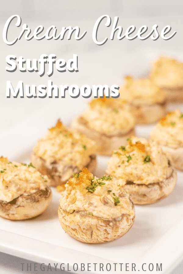 "Cream cheese stuffed mushrooms on a plate with text overlay that says ""cream cheese stuffed mushrooms"""