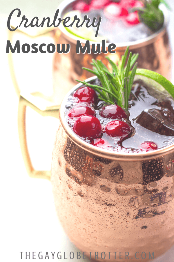 "A close up of cranberrry moscow mules with text overlay that says ""Cranberry Moscow Mule""."