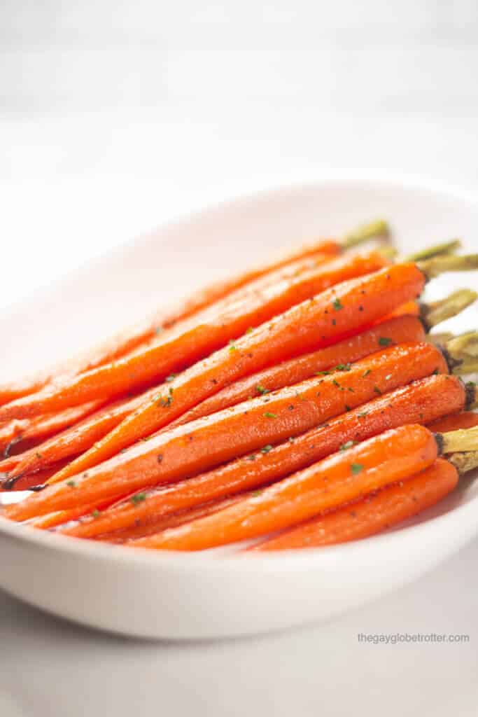 Honey glazed carrots on a serving platter.