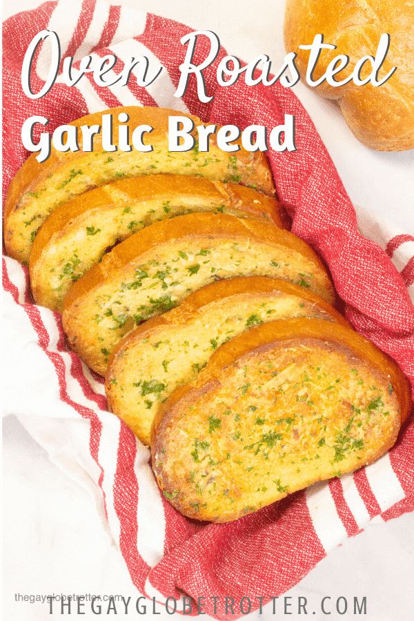 "Roasted garlic bread in a basked with text overlay that reads ""oven roasted garlic bread."""