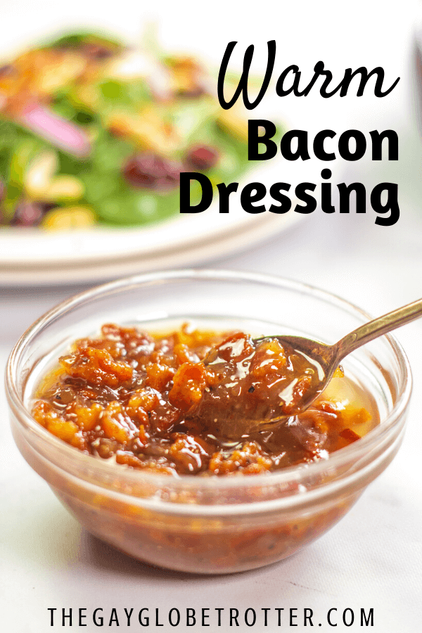 Warm bacon dressing in a serving bowl with a spoon.