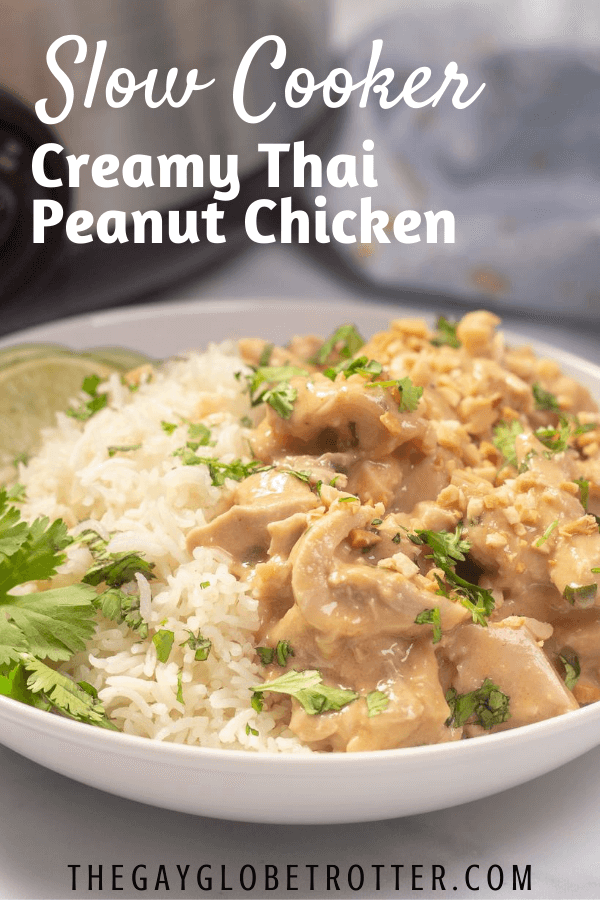 "A bowl of thai peanut chicken with text overlay that says ""slow cooker thai peanut chicken"""