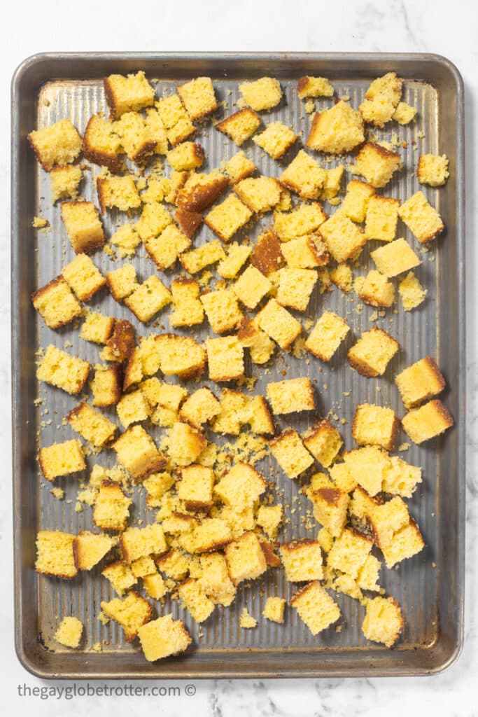 A tray of cornbread cubes being dried.