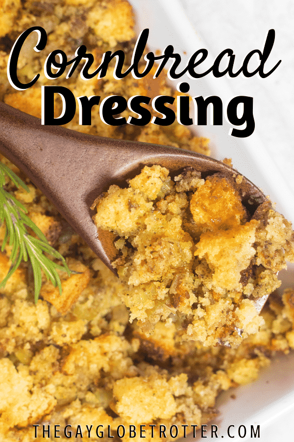 Cornbread stuffing being served with a wooden serving spoon.