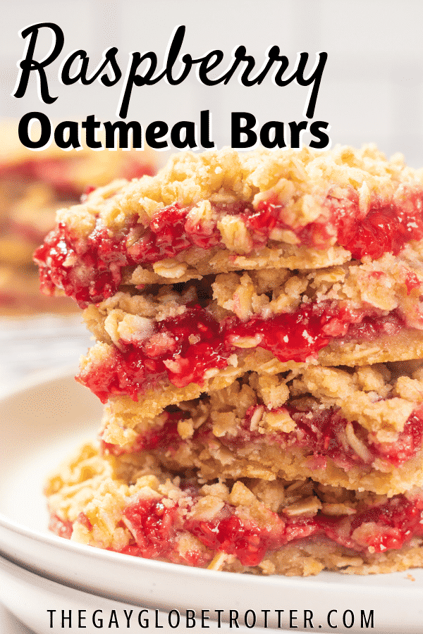 Raspberry oatmeal bars in a stack on a plate.