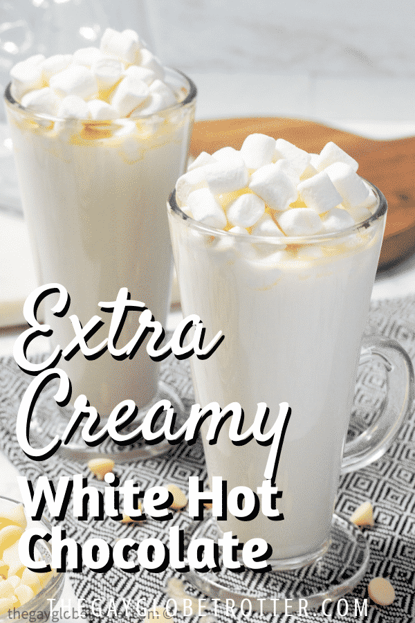 White hot chocolate topped with marshmallows in clear cups.