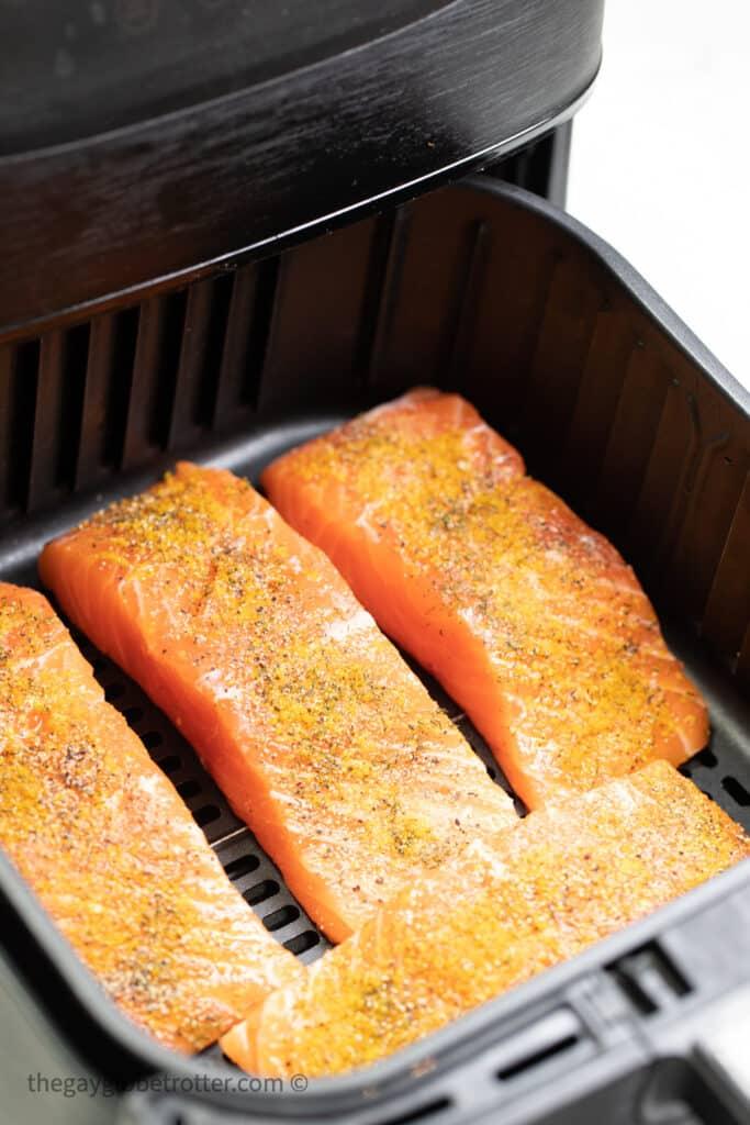 Seasoned salmon in the air fryer.