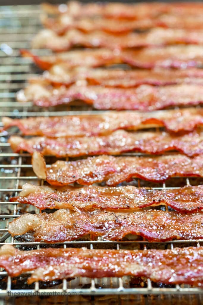 Candied bacon cooling on a wire rack.