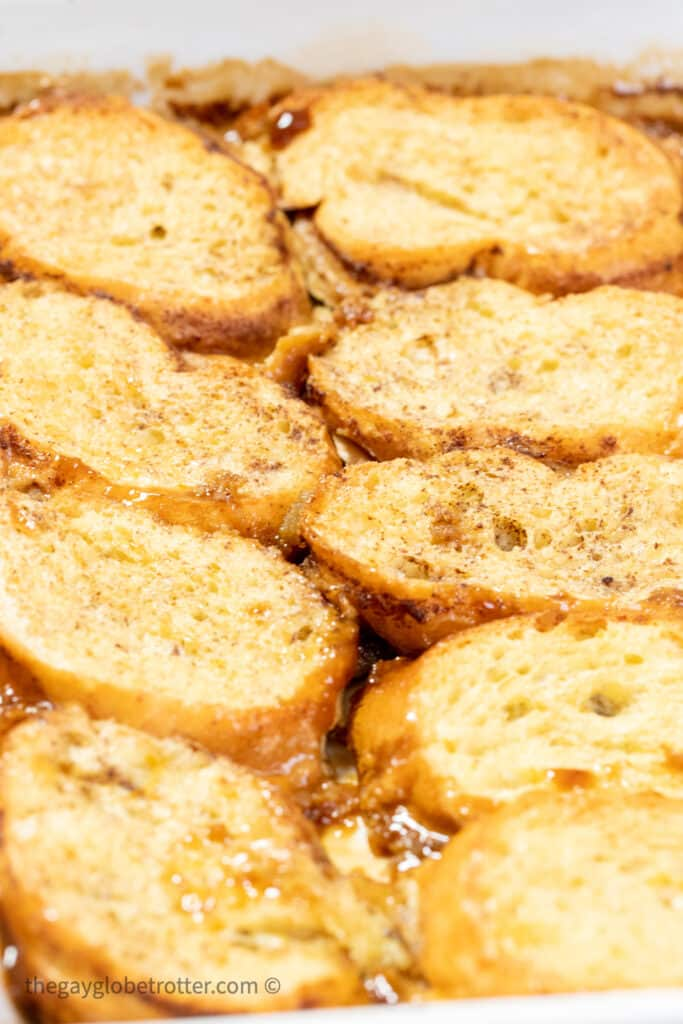 Creme brulee french toast in a pan in the oven.