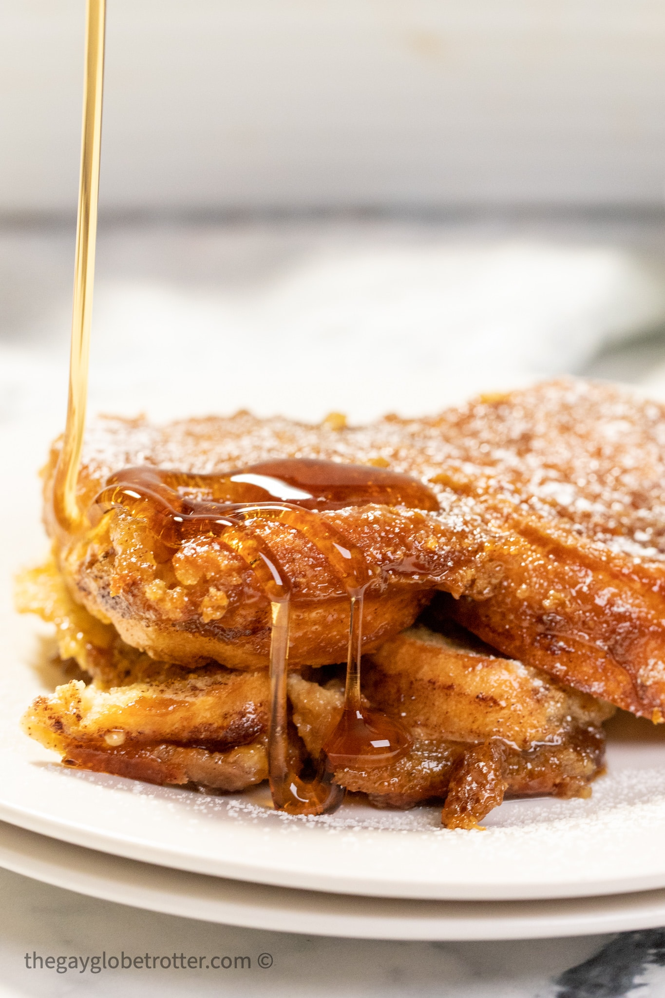 Syrup being drizzled over creme brulee french toast.