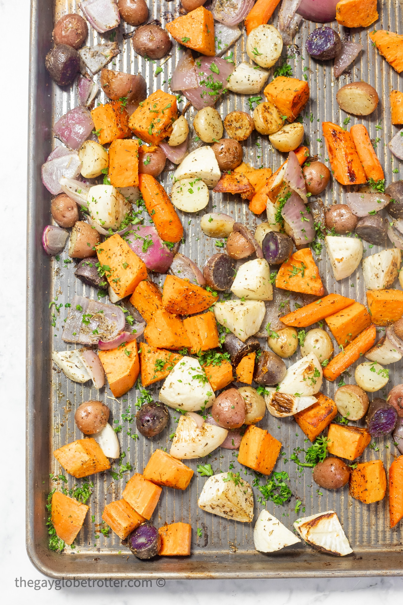 Roasted root vegetables topped with parsley.