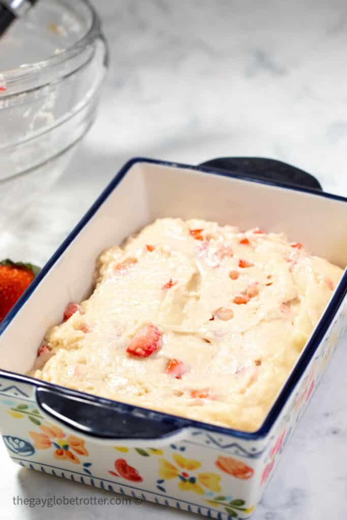 Strawberry bread batter in a bread pan.