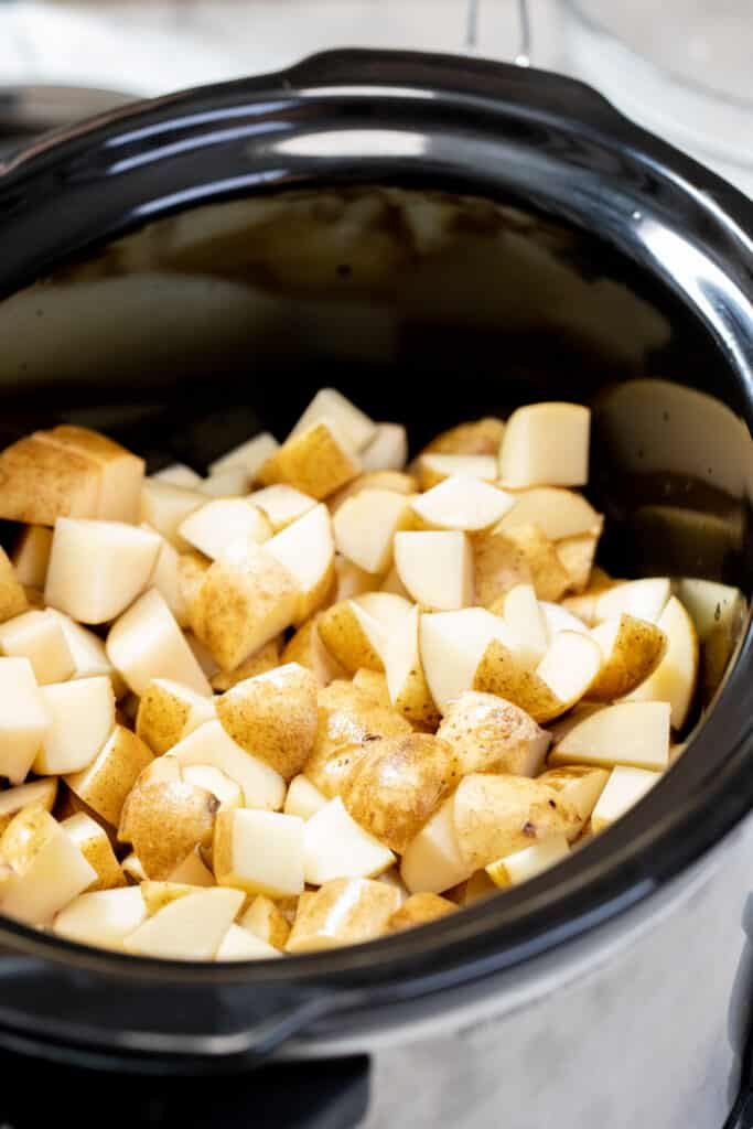 Potato cubes in a slow cooker.