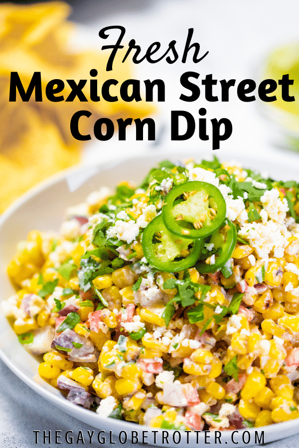 Mexican street corn dip in a serving dish with text overlay.