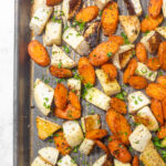 A baking sheet with roasted turnips and carrots.