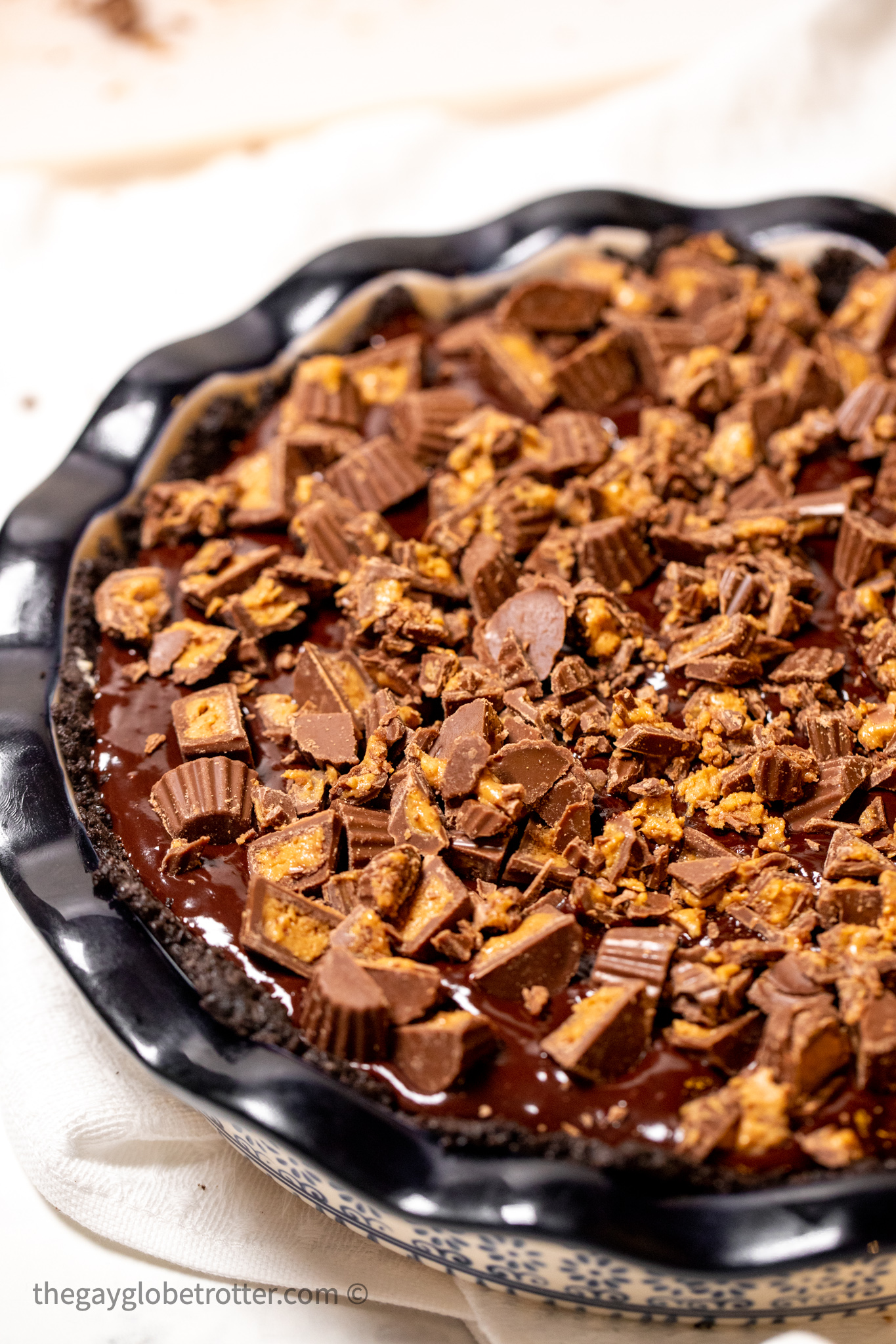 Chocolate peanut butter pie in a serving dish.