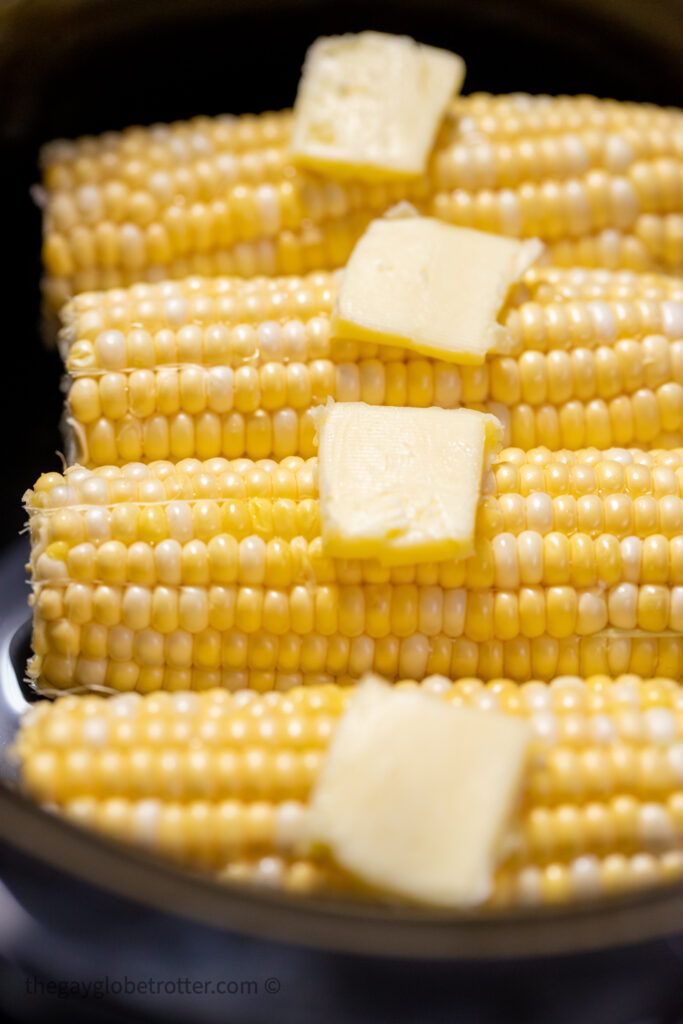 Butter on raw corn on the cob in a CrockPot.