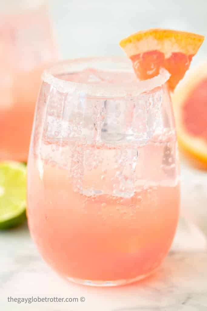 A paloma garnished with a grapefruit wedge.