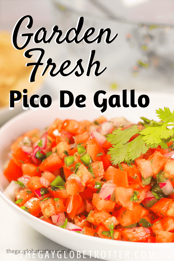 A bowl of pico de gallo topped with fresh cilantro and jalapenos.