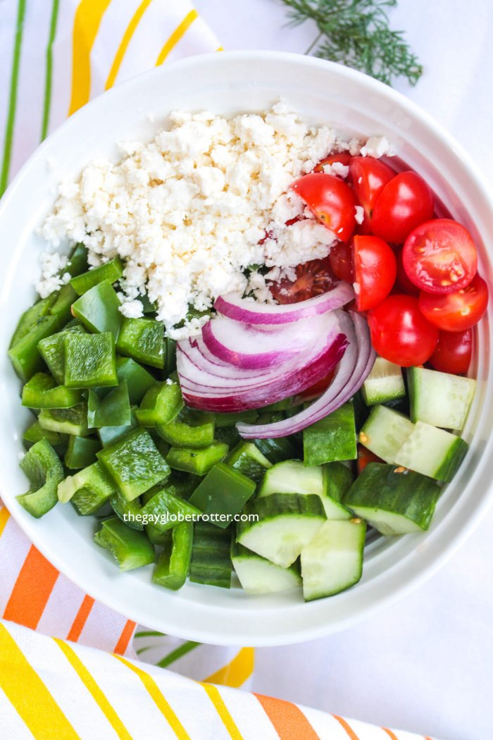 This homemade Greek salad recipe is topped with homemade Greek salad dressing for a fresh salad like no other!